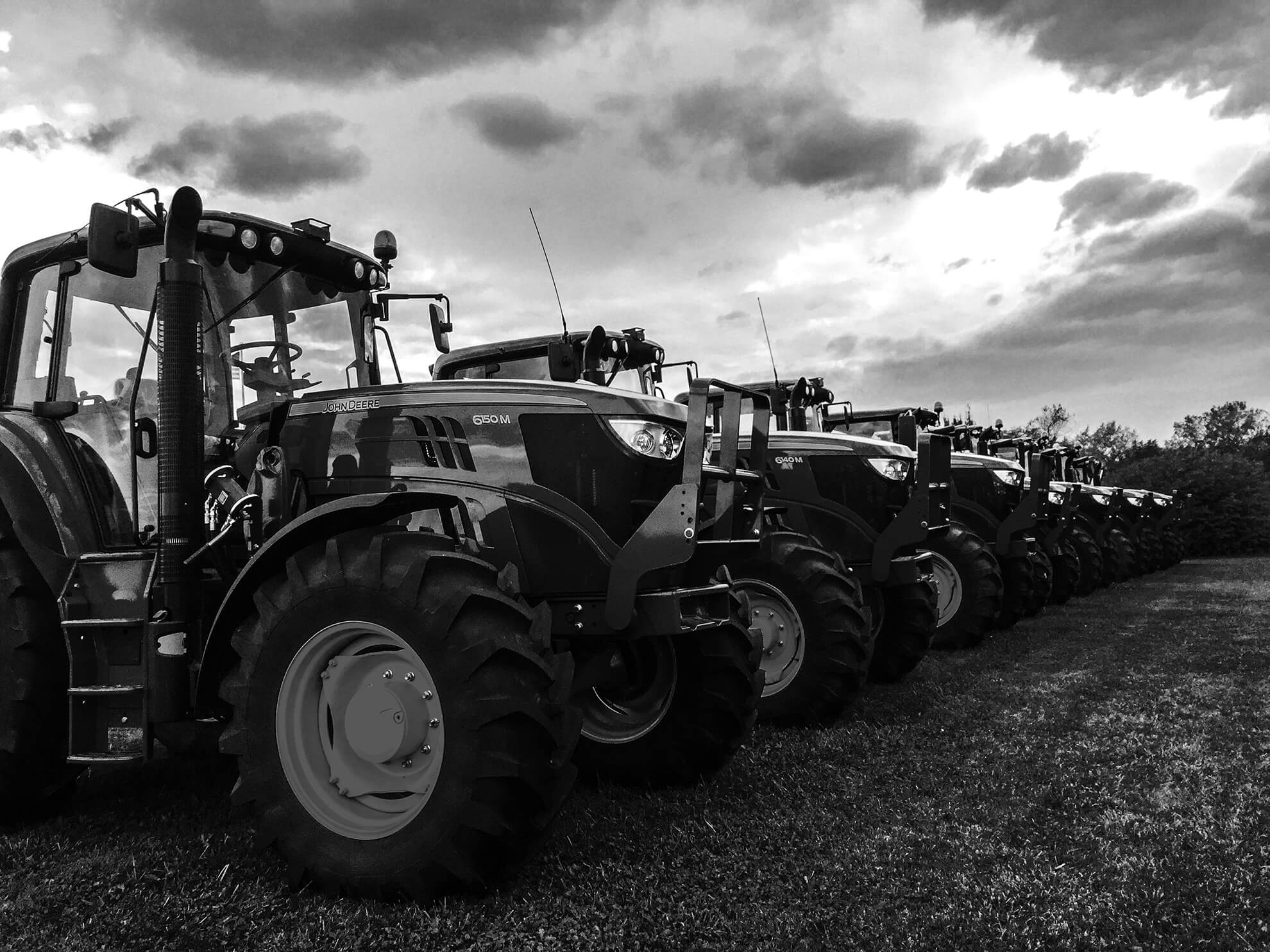 Tractors are lined up and parked.