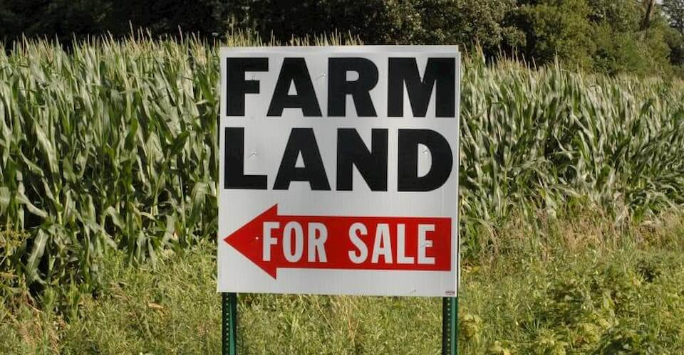 A Farm Land For Sale sign