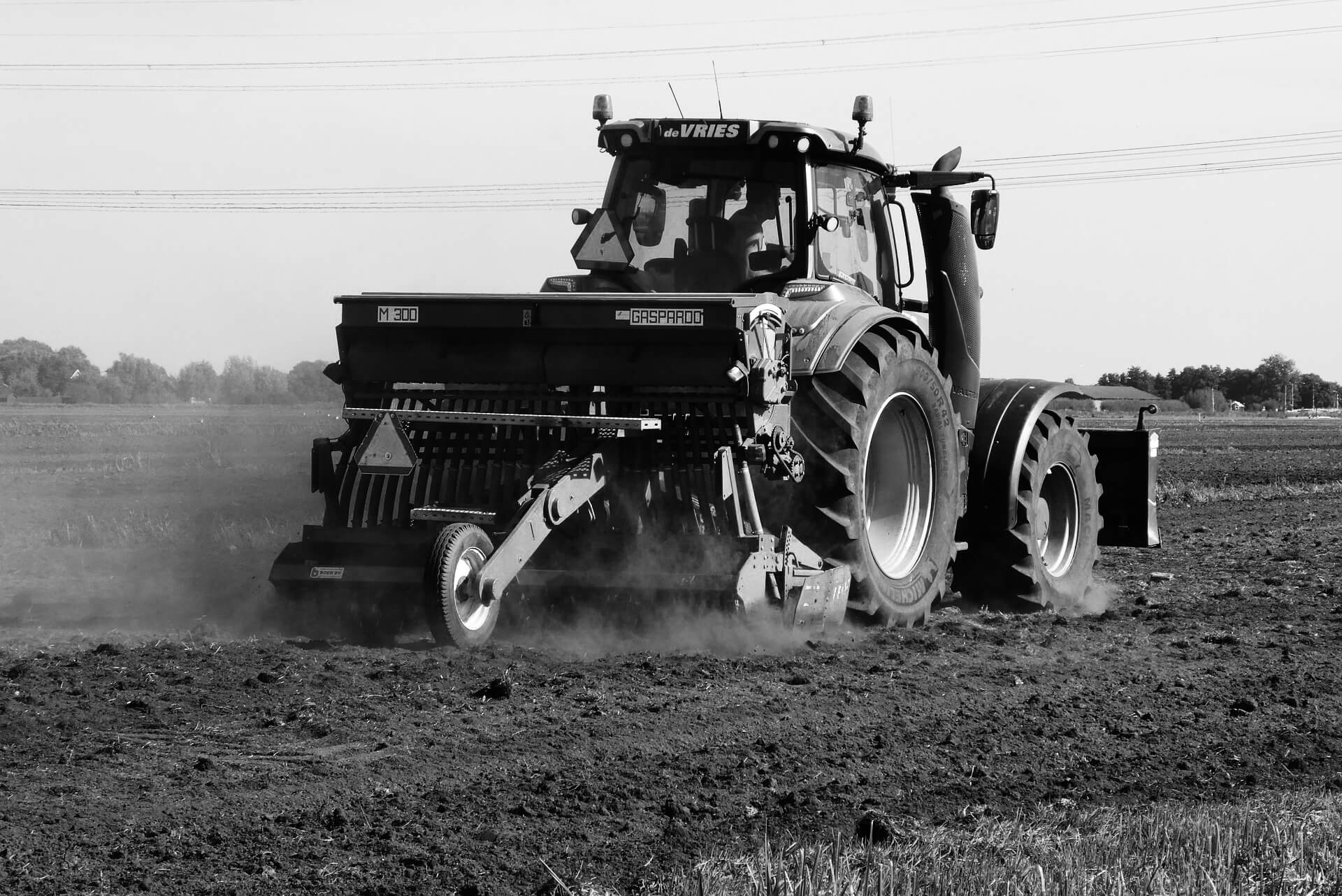 A tractor moves through a field.