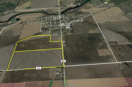 An aerial view of a plot of farmland for sale
