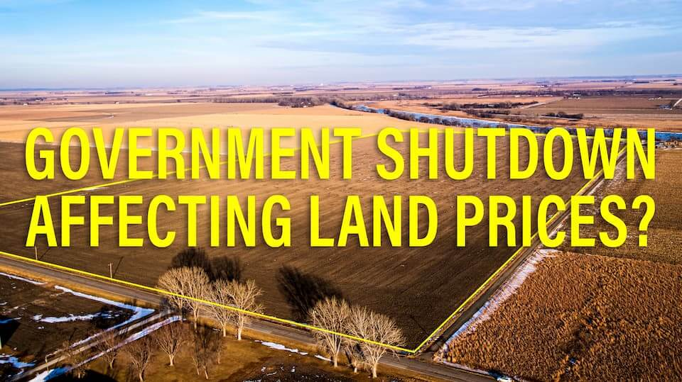 """Photo of land with text, """"GOVERNMENT SHUTDOWN AFFECTING LAND PRICES?"""""""
