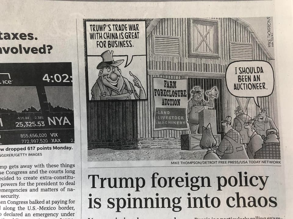 A picture of a political cartoon highlighting effects of the trade war on farm business.