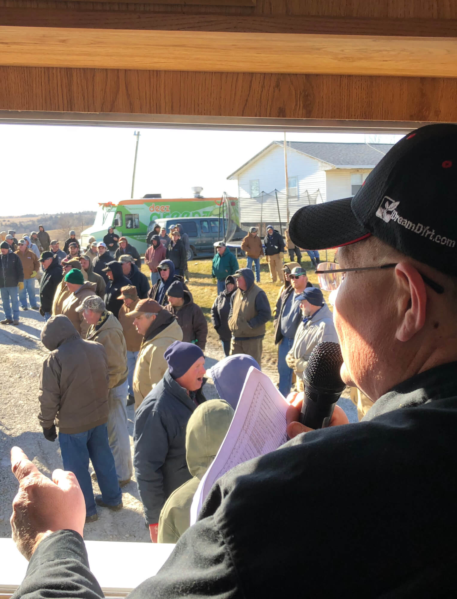 crowd at auction with auctioneer selling